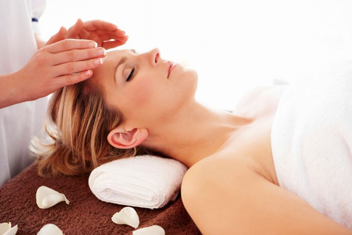 image of woman receiving energy healing therapy